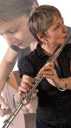 Photo of Sister Dorothy playing flute and acoustic guitar